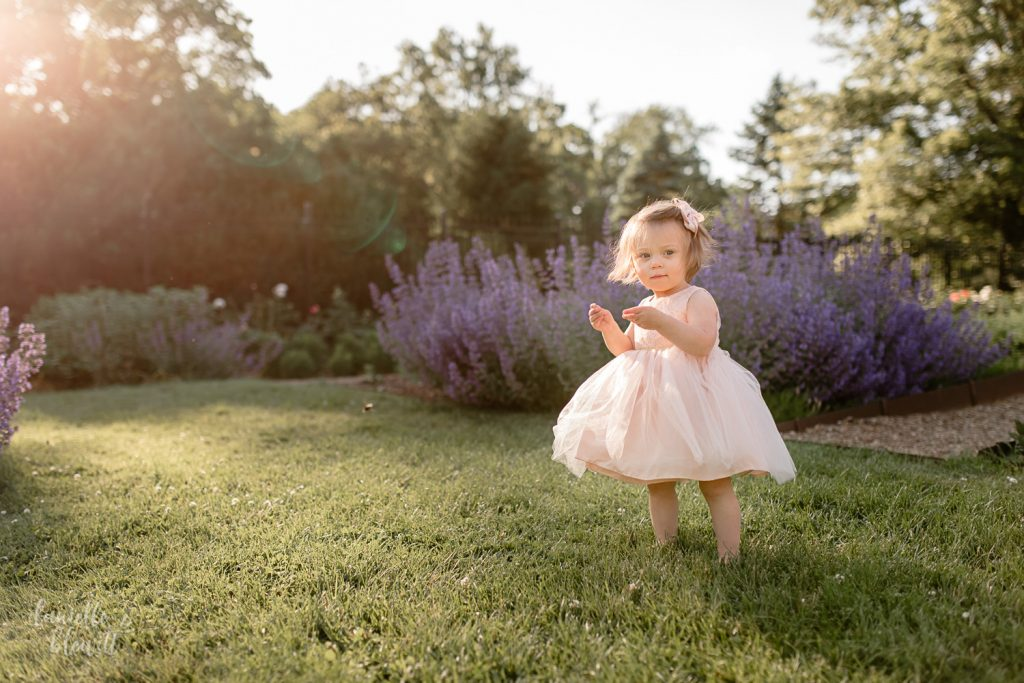 sun flare during first birthday photography session at golden hour